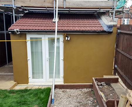 Painted external render on an extension at a house in Croydon