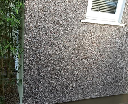 Pebble dashing on an external wall on a house in Croydon