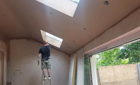 A plasterer doing plastering work in Croydon